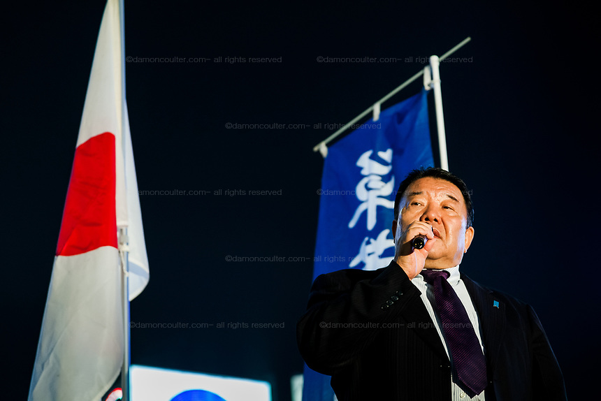 Satoru Mizushima one of the founders of the right-wing political group,,  Ganbare Nippon speaks at a campaign rally in Hachiko Square, Shibuya, Tokyo, Japan. Friday November 28th 2014