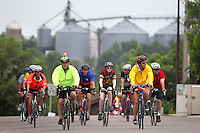 Riders make their way into Gilbertville Friday morning on RAGBRAI XXXVIII.
