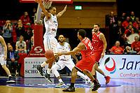 GRONINGEN - Basketbal, Donar - Spirou Basket, Martiniplaza, Europe Cup, seizoen 2018-2019, 20-11-2018, Donar speler Jason Dourisseau verdedigt tegen Spirou speler Cliff Hammonds