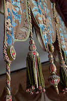 Passementerie hangings are a feature of the four-poster bed in the Colonel's room