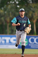 Lynchburg Hillcats outfielder Andrew Calica (8) running in to the dugout during a game against the Myrtle Beach Pelicans at Ticketreturn Field at Pelicans Ballpark on April 15, 2017 in Myrtle Beach, South Carolina. Lynchburg defeated Myrtle Beach 5-3. (Robert Gurganus/Four Seam Images)