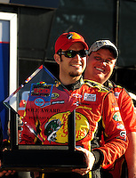 Feb 08, 2009; Daytona Beach, FL, USA; NASCAR Sprint Cup Series driver Martin Truex Jr (front) with crew chief Kevin Manion after winning the pole position following qualifying for the Daytona 500 at Daytona International Speedway. Mandatory Credit: Mark J. Rebilas-