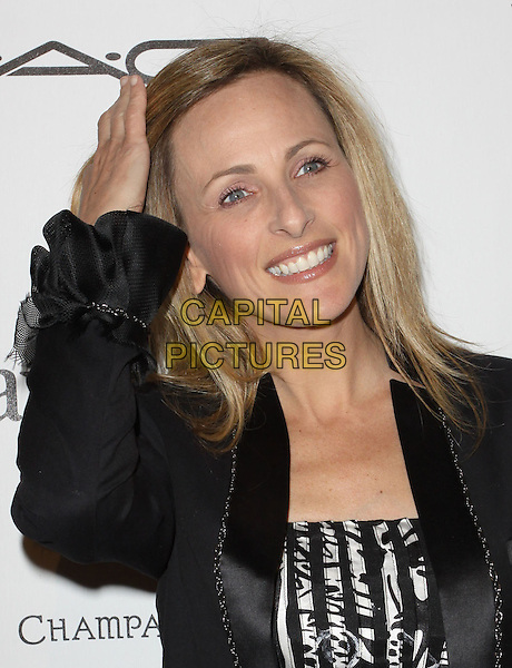 MARLEE MATLIN.3rd Annual Women In Film Pre-Oscar Party held At A Private Residence, Bel Air, California, USA..March 4th, 2010.half length hand on head in hair smiling black white print patterned pattern.CAP/ADM/KB.©Kevan Brooks/AdMedia/Capital Pictures.