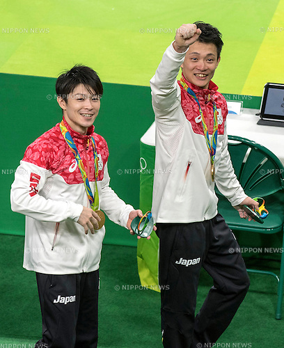 (L-R) Kohei Uchimura, Yusuke Tanaka (JPN),<br /> AUGUST 8, 2016 - Artistic Gymnastics :<br /> Kohei Uchimura and Yusuke Tanaka of Japan celebrate after receiving the gold medal during the Men's Team Medal Ceremony at Rio Olympic Arena during the Rio 2016 Olympic Games in Rio de Janeiro, Brazil. (Photo by Enrico Calderoni/AFLO SPORT)