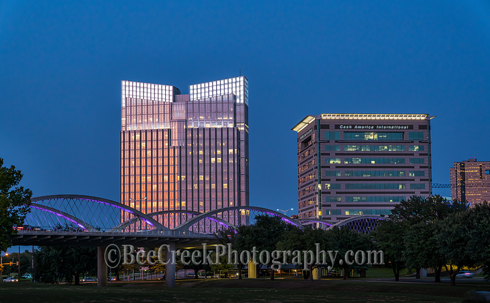 Seventh street bridge after dark in downtown Fort Worth.  This image show the bridge lit up with purple colors as the twilight sky and the buildings light up for the evening in the city.