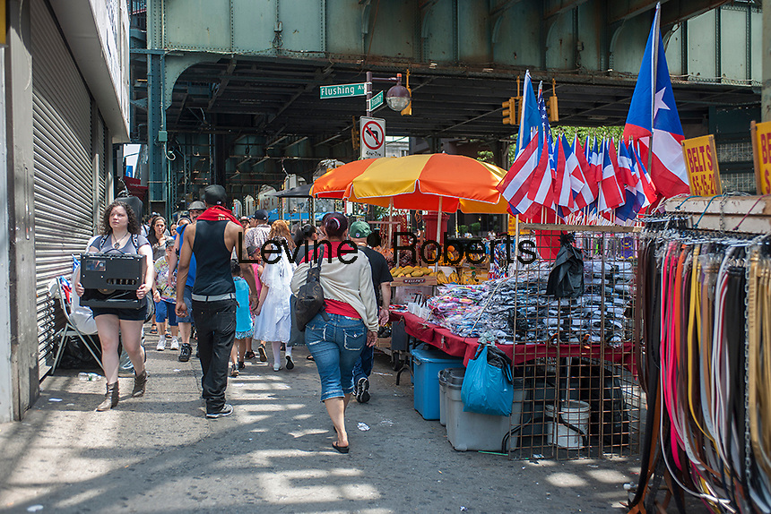 Street vendors on the busy Graham Avenue CBD in the Bushwick neighborhood of Brooklyn in New York on Sunday, June 2, 2013. As more and more hipsters move into the neighborhood the ethnicity of the area is changing.   (© Richard B. Levine)