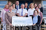 Staff at the Bank of Ireland branch Tralee hand over a cheque of €8763.90 to Saint Vincent de Paul Tralee, the highest among raised from the national Blue Box Day campaign in May. Pictured were: Junior Locke (SVdP), and Maura Moran (BOI) with Elaine O'Keeffe, Hugh Gleeson, John Walker, Mary O'Donnell, Eileen McNamara, Frances O'Connell, Eimear Carey and Caitriona O'Mahony.