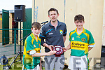 Tommy Cronin (Chairman of Coiste Na nÓg) presents the U14 Hurling B Feile Cup to Lixnaw's joint captains Evan Kelliher and Darren O'Brien in Abbeydorney on Monday.  dan O'Sullivan.