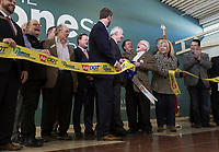 NWA Democrat-Gazette/CHARLIE KAIJO Outgoing Arkansas Highway Commission Chair Dick Trammel (fourth from right) reacts during a ribbon cutting, January 4, 2019 at the Jones Center in Springdale. <br />