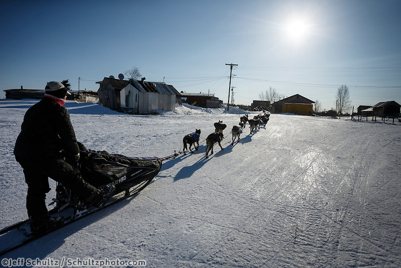 Jessie Royer runs into the Kaltag checkpoint on Saturday March 8, during the Iditarod Sled Dog Race 2014.<br /> <br /> PHOTO (c) BY JEFF SCHULTZ/IditarodPhotos.com -- REPRODUCTION PROHIBITED WITHOUT PERMISSION