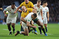 Jonny May of England tackled by Stephen Moore of Australia during the Old Mutual Wealth Series match between England and Australia at Twickenham Stadium on Saturday 3rd December 2016 (Photo by Rob Munro)