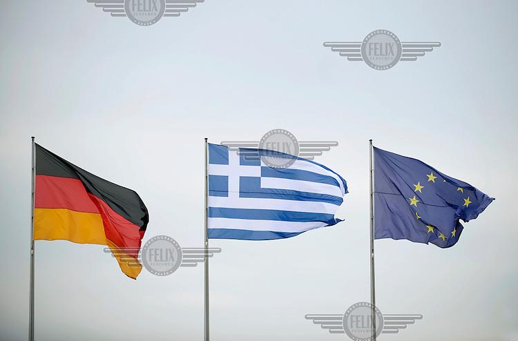 The German flag, Greek flag and European Union flag at a state visit of Greek Prime Minister Antonis Samaras.