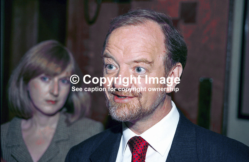 Robin Cook, UK Labour MP &amp; Foreign Secretary, with wife, Gaynor Cook, in the background. Taken at Labour Party Annual Conference. Ref: 199810262.<br /> <br /> Copyright Image from Victor Patterson,<br /> 54 Dorchester Park, <br /> Belfast, UK, BT9 <br /> <br /> t1: +44 28 9066 1296 (from Rep of Ireland 048 90661296)<br /> t2: +44 28 9002 2446 (from Rep of Ireland 048 9002 2446)<br /> <br /> m: +44 7802 353836<br /> <br /> e: victorpatterson@me.com<br /> www.victorpatterson.com<br /> <br /> Please see my Terms and Conditions of Use at www.victorpatterson.com. It is IMPORTANT that you familiarise yourself with them.<br /> <br /> Images used on the Internet must be visibly watermarked i.e. &copy; Victor Patterson<br /> within the body of the image and copyright metadata must not be deleted. Images <br /> used on the Internet have a size restriction of 4kbs and will be chargeable at current<br />  NUJ rates unless agreed otherwise.<br /> <br /> This image is only available for the use of the download recipient i.e. television station, newspaper, magazine, book publisher, etc, and must not be passed on to any third <br /> party. It is also downloaded on condition that each and every usage is notified within 7 days to victorpatterson@me.com<br /> <br /> The right of Victor Patterson to be identified as the author is asserted in accordance with The Copyright Designs And Patents Act (1988). All moral rights are asserted.