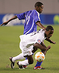 11 March 2008: Robbie Findley (USA) (14) goes down from the challenge of Yordany Alvarez (CUB) (10). The United States U-23 Men's National Team tied the Cuba U-23 Men's National Team 1-1 at Raymond James Stadium in Tampa, FL in a Group A game during the 2008 CONCACAF's Men's Olympic Qualifying Tournament.