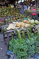 Myanmar, Burma.  Bananas and Coconuts in the Mandalay Market.