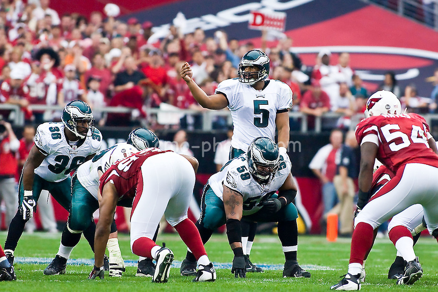 Jan 18, 2009; Glendale, AZ, USA; Philadelphia Eagles quarterback Donovan McNabb (5) gestures to a teammate while running back Brian Westbrook (36), offensive lineman Nick Cole (59), Arizona Cardinals defensive end Calais Campbell (93), and linebacker Gerald Hayes (54) await the snap in their stances in the first half of the NFC Championship Game at University of Phoenix Stadium.  The Cardinals won the game 32-25 to advance to Super Bowl XLIII.