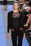Ella walks runway in a carbon black Chantilly lace v-neck cardigan, carbon black Chantilly lace ¾ sleeve knit shell, and cyan blue crepe corset with python lace overlay, by Monique Lhuillier, from the Monique Lhuillier Spring 2012 collection fashion show, during Mercedes-Benz Fashion Week Spring 2012.