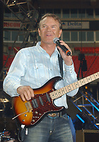 "08 August 2017 - Various - Glen Campbell, the voice behind 21 Top 40 hits including ""Rhinestone Cowboy,"" ""Wichita Lineman"" and ""By the Time I Get to Phoenix,"" died Tuesday. He was 81. During a career that spanned six decades, Campbell sold over 45 million records. In 1968, he outsold the Beatles. Campbell was married four times, and has five sons and three daughters. In the early 1980s, while battling alcoholism and cocaine addiction, Campbell made tabloid headlines with a 15-month, high-profile relationship with country singer Tanya Tucker, who was 22 years his junior. In 1981, he became a born-again Christian and in 1982 he married Kimberly Woollen, a Radio City Music Hall Rockette. In 2003, he was arrested for a hit-and-run, an incident that ended with him allegedly kneeing a police officer in the thigh right before he was released. Campbell pleaded guilty to extreme drunken driving and leaving the scene of an accident, and spent 10 days in jail. In 2011, Campbell, then 75, revealed that he was diagnosed with Alzheimer's disease. In June of that year, he announced he was retiring from music due to the disease. He released his final album of original music Ghost and embarked on a farewell tour with three of his children backing him. File Photo: June 13, 2004; Nashville, TN, USA; Singer GLEN CAMPBELL during the 2004  CMA Music Festival held at the Coliseum. Glen Campbell, who pleaded guilty last month to extreme drunken driving and leaving the scene of an accident, had his sentence delayed so he could perform Sunday at the CMA Music Festival. Photo Credit: Photo by Laura Farr/AdMedia"