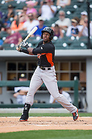 Julio Borbon (5) of the Norfolk Tides follows through on his swing against the Charlotte Knights at BB&T BallPark on June 7, 2015 in Charlotte, North Carolina.  The Tides defeated the Knights 4-1.  (Brian Westerholt/Four Seam Images)