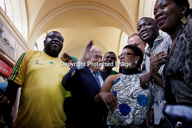 JOHANNESBURG, SOUTH AFRICA - FEBRUARY 10: FIFA president Sepp Blatter is surrounded by fans when he visited Nelson Mandela Square, an upmarket shopping mall on February 10, 2013 in Sandton, Johannesburg, South Africa. Mr. Blatter visited South Africa to watch the final game of the CAP, Africa's Cup of Nations between Nigeria and Burkina Faso. (Photo by Per-Anders Pettersson)