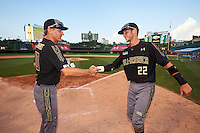 Carter Kieboom (22) of Walton High School in Marietta, Georgia congratulated by Steve Bernhardt after being named his teams Most Valuable Player Award after the Under Armour All-American Game on August 15, 2015 at Wrigley Field in Chicago, Illinois. (Mike Janes/Four Seam Images)