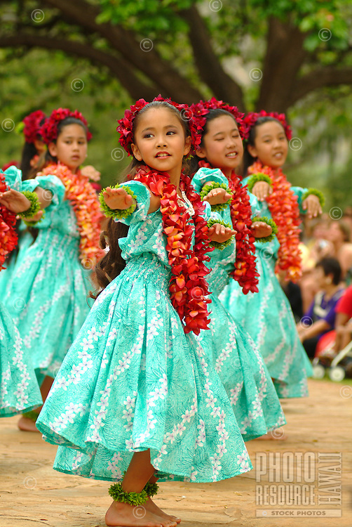 Keiki hula dancers from Halau Hula O Hokulani dancing at the Kapiolani park on Lei Day.