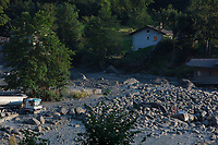 Switzerland. Canton Graubunden. Bregaglia valley. Bondo. A second massive landslide hit Bondo while the remote village was still recovering from a huge landslide caused by a giant rockslide swept down from Piz Cengalo on August 23, 2017. The mudslide smash a bridge, barns, the carpentry factory and equipment that was being used to clear debris from the previous landslide. 25.08.2017 © 2017 Didier Ruef