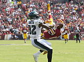 Washington Redskins cornerback Josh Norman (24) breaks up a pass intended for Philadelphia Eagles wide receiver Torrey Smith (82) in first quarter action at FedEx Field in Landover, Maryland on Sunday, September 10, 2017.<br /> Credit: Ron Sachs / CNP