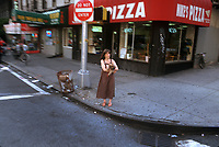 Woman on  a street corner with a dog, NY 1997