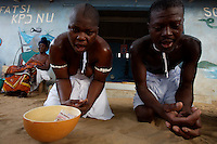 """Dayametoor, 16 years ol, on left and Akapo, two """"trokosi"""" religious slaves  perform a pagan traditional ritual under the supervision of their priestess  in one of the shrines of Atito in the Volta region, Ghana on Saturday March 10 2007.."""