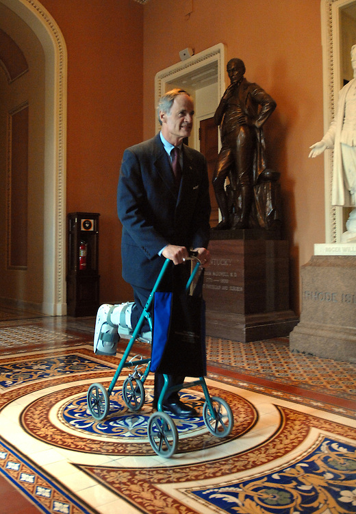 Sen. Tom Carper, D-Del., pushes himself through the Capitol on a contraption supporting his leg that was injured while running a half marathon.  The device is called a Roll-A-Bout and manufactured by a Delaware company.