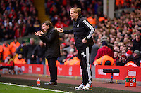 Sunday, 23 February 2014<br /> Pictured: Swansea City's Manager Garry Monk gestures to his players from the touchline <br /> Re: Barclay's Premier League, Liverpool FC v Swansea City FC v at Anfield Stadium, Liverpool Merseyside, UK.