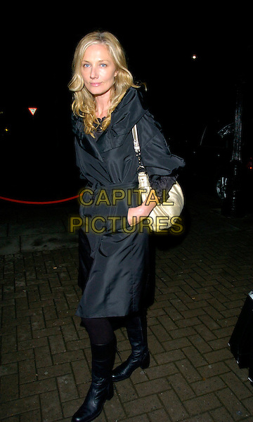 JOELY RICHARDSON.TAG Heuer Strength & Beauty Exhibition - opening night party, Royal College Of Art (RCA), London, UK..February 8th, 2007.full length black boots coat jacket mac hand in pocket white cream satin bag purse .CAP/CAN.©Can Nguyen/Capital Pictures