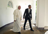 U.S. President Barack Obama (R) and Pope Francis (L) walk through the colonnade prior to an Oval Office meeting at the White House on September 23, 2015 in Washington, DC. The Pope begins his first trip to the United States at the White House followed by a visit to St. Matthew's Cathedral, and will then hold a Mass on the grounds of the Basilica of the National Shrine of the Immaculate Conception. <br /> Credit: Alex Wong / Pool via CNP