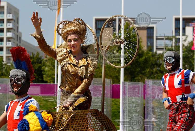 Performers perform during the welcome ceremony of the participant countries of the London 2012 Olympic Games, in the Olympic Village in Stratford.