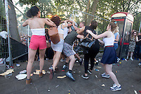 Photographer: Rick Findler<br /> <br /> 26.08.13 Notting Hill Carnival had some good times and bad this evening on it's last night of 2013. Trouble grabbed the attention of a lot of the revellers as some started fighting and others had had a bit too much to drink.