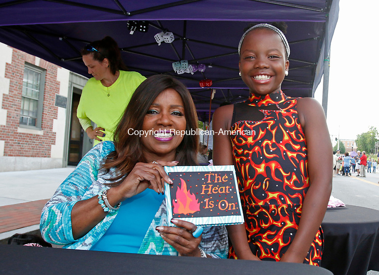 Torrington, CT- July 072717MK01 Gloria Gaynor holds a scrap book that Emily Lapointe gave to her at the Main Street Marketplace in Torrington Thursday evening. Lapointe danced to Gaynor's music during multiple championships as well as a recent national competition.  Gloria Gaynor greeted dozens of fans and took photos with them along with signing autographs at the event.  Michael Kabelka / Republican-American