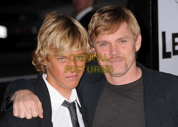 """LUKE & RICK SCHRODER.""""Leatherheads"""" Los Angeles Premiere at Grauman's Chinese Theatre, Hollywood, California, USA..March 31st, 2008.headshot portrait ricky father dad family arm over shoulder black moustache mustache facial hair .CAP/ADM/BP.©Byron Purvis/AdMedia/Capital Pictures."""