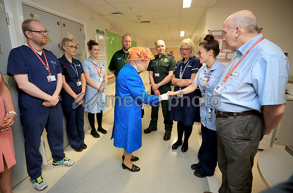 25 May 2017 - Queen Elizabeth II during a visit to the Royal Manchester Children's Hospital to meet victims of the terror attack in the city earlier this week and to thank members of staff who treated them. Photo Credit: ALPR/AdMedia