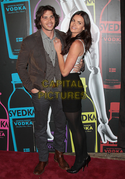 Ben Flajnik, Courtney Robertson.The Second Annual 'Night of a Billion Reality Stars' Bash held at the Supperclub, Los Angeles, California, USA, 29th March 2012..full length  black skirt silver vest top tights .CAP/ADM/SLP/JO.©James Orken/Starlitepics/AdMedia/Capital Pictures.