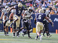Annapolis, MD - October 21, 2017: UCF Knights running back Taj McGowan (12) tries to avoid Navy Midshipmen defenders during the game between UCF and Navy at  Navy-Marine Corps Memorial Stadium in Annapolis, MD.   (Photo by Elliott Brown/Media Images International)