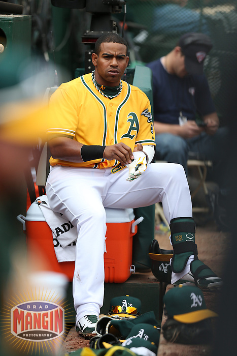 OAKLAND, CA - APRIL 4:  Yoenis Cespedes #52 of the Oakland Athletics watches from the dugout during the game against the Seattle Mariners at O.co Coliseum on April 4, 2013 in Oakland, California. Photo by Brad Mangin