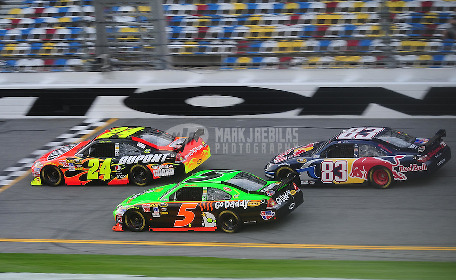 Feb 4, 2010; Daytona Beach, FL, USA; NASCAR Sprint Cup Series driver Jeff Gordon (24) leads Mark Martin (5) and Brian Vickers (83) during practice for the Bud Shootout at Daytona International Speedway. Mandatory Credit: Mark J. Rebilas-