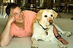 Mature man lying beside dog
