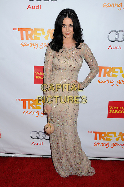 "Katy Perry.The Trevor Project's ""Trevor Live"" 2012 held at the Hollywood Palladium, Hollywood, California, USA..December 2nd, 2012.full length dress long sleeves bag purse beige white lace cream braid plait hair silver gold sequins sequined hand on hip.CAP/ADM/BP.©Byron Purvis/AdMedia/Capital Pictures."