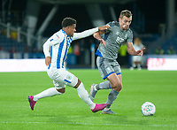 Lincoln City's Harry Toffolo battles with Huddersfield Town's Josh Koroma<br /> <br /> Photographer Andrew Vaughan/CameraSport<br /> <br /> The Carabao Cup First Round - Huddersfield Town v Lincoln City - Tuesday 13th August 2019 - John Smith's Stadium - Huddersfield<br />  <br /> World Copyright © 2019 CameraSport. All rights reserved. 43 Linden Ave. Countesthorpe. Leicester. England. LE8 5PG - Tel: +44 (0) 116 277 4147 - admin@camerasport.com - www.camerasport.com