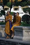 After a long day of studying, Buddhists priests relax near a temple in Bangkok, Thailand. (Jim Bryant Photo).....