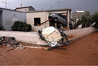 Pictured: A car is embedded into the porch of  house.<br /> Re: People have died, some still missing and severe damage caused by heavy rain and flash flooding in the area of Mandra, near Athens, Greece. Thursday 16 November 2017