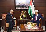 Palestinian President Mahmoud Abbas meets with Jordanian Minister of Culture, at his headquarters in the West Bank city of Ramallah on May 4, 2018. Photo by Thaer Ganaim