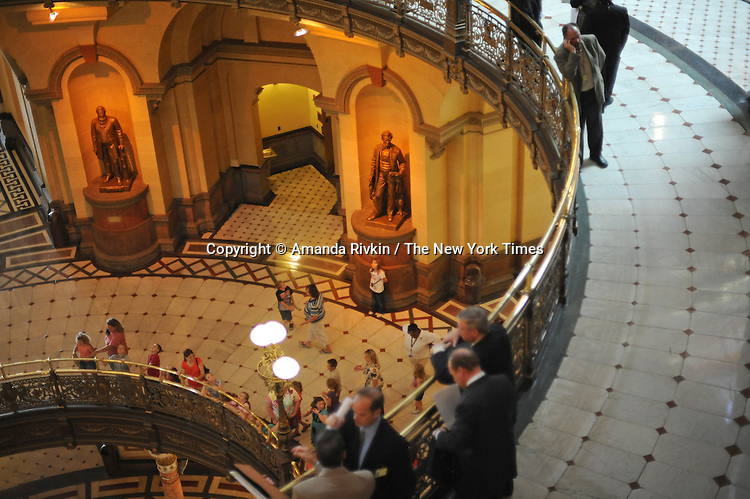 Lobbyists (top) and visitors (below) stand around the rotunda of the Illinois State Capitol midday during one of the closing marathon legislative sessions, expected to end Sunday, that marks the end of the legislative year in Springfield, Illinois on May 27, 2009.
